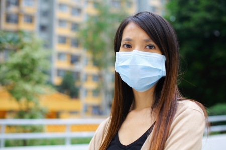 smog: Asian woman wear protective face mask Stock Photo