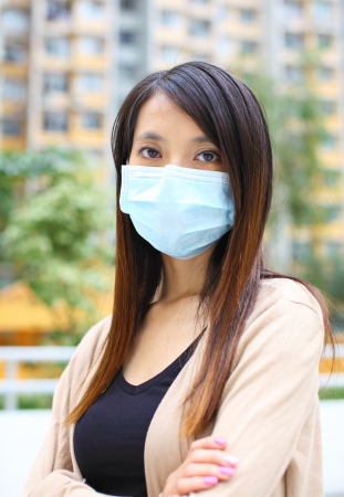 deterrence: Asian woman wearing face mask Stock Photo