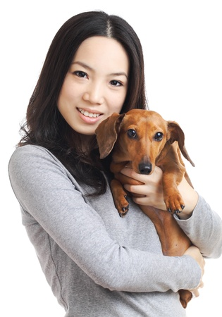 asian woman with dachshund dog  photo