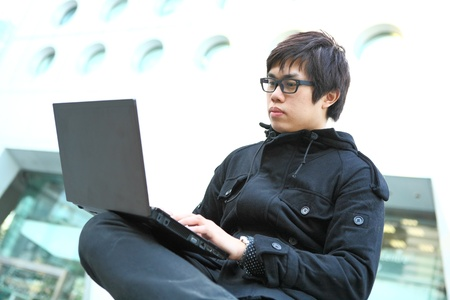 man using laptop computer photo