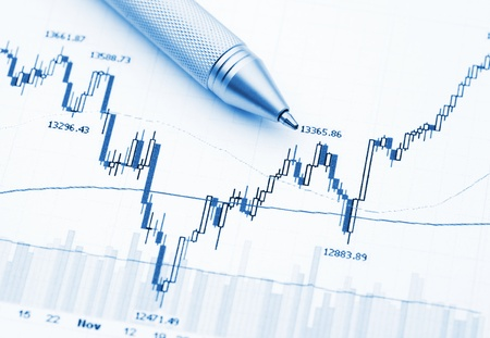Business financial chart with pen  photo