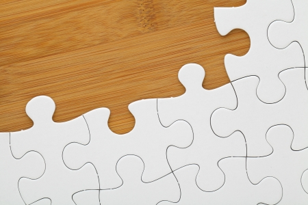Puzzle on wooden board photo