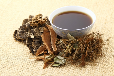 traditional chinese medicine: Herbal drink on the linen table