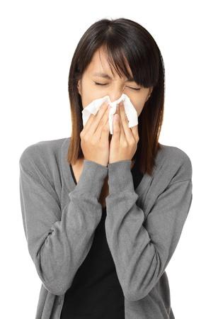 sniffles: Sneezing woman Stock Photo