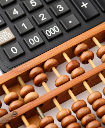 Calculator and abacus photo