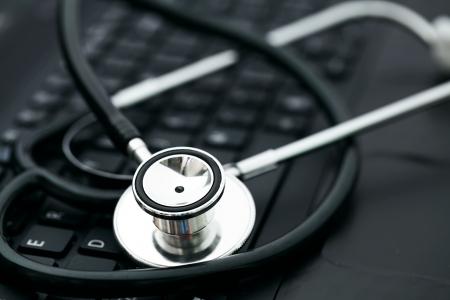 Stethoscope on computer keyboard photo