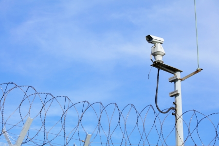 CCTV on top of chain link  photo
