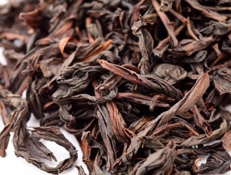 Chinese black tea isolated on white background photo