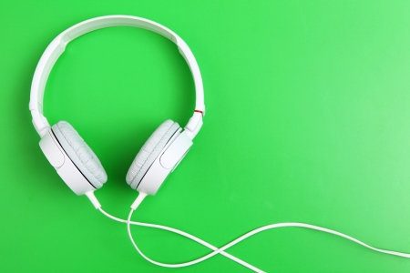 headset voice: Headphone on green background