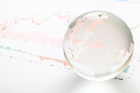 conceptional: Glass earth ball on the financial chart