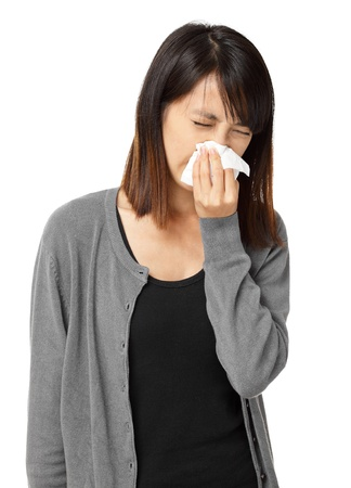 Cold sneezing asian woman photo