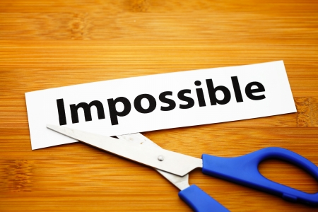 prefix: Word impossible cut to possible over wood background