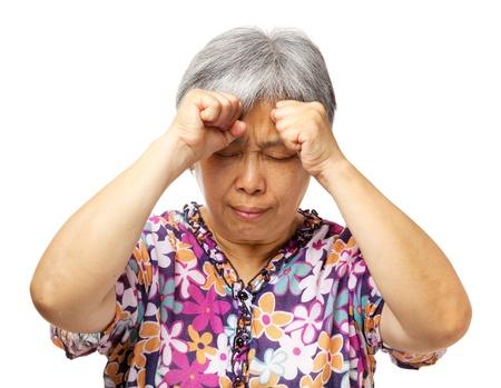 woman serious: Mature asian woman serious headache Stock Photo