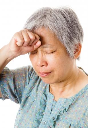 Mature asian woman feel headache Stock Photo - 21350127