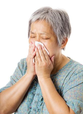 Sneezing mature asian woman Stock Photo - 21350231