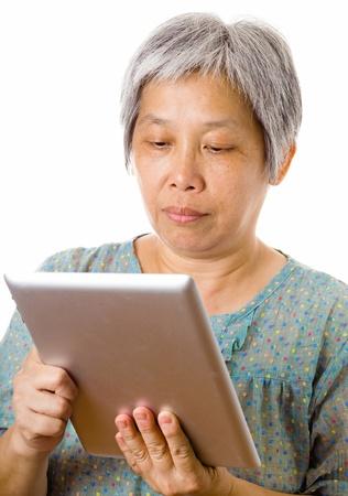 Asian elderly using tablet photo