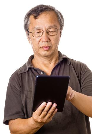 asian old man: Asian old man using tablet