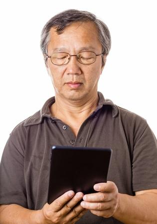 Asian man using tablet photo