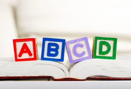 Alphabet block with ABCD on book  Stock Photo
