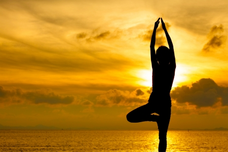 Silhouette of beautiful Yoga woman in morning photo