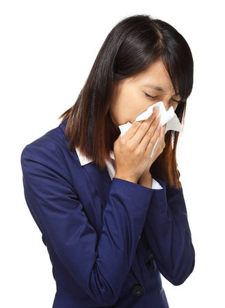 Cold sneezing asian business woman photo
