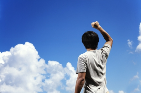 Man clench fist facing the sky photo