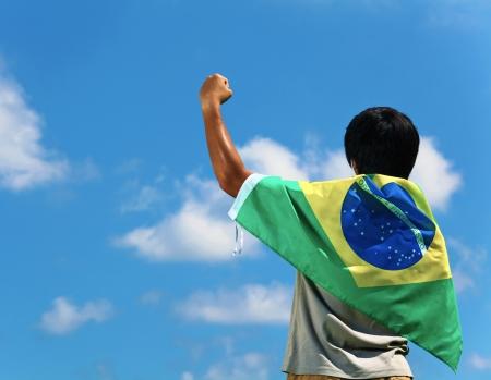 brazil flag: Brazil supporter hand up