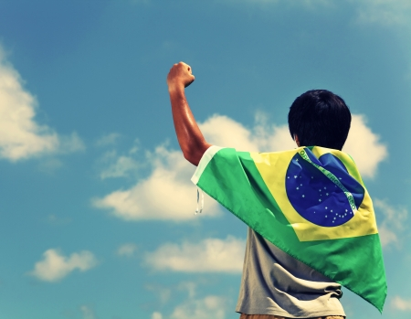 Excited man holding a brazil flag 版權商用圖片