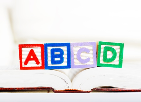 abcd: Alphabet block with ABCD on book