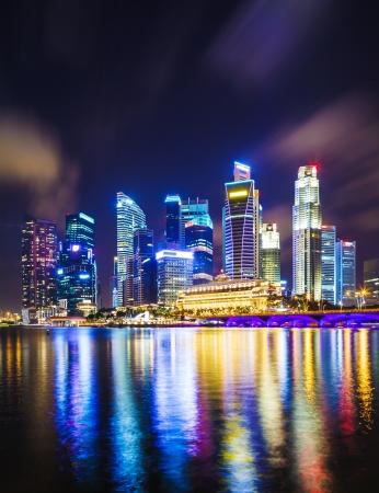 Singapore skyline at night Imagens