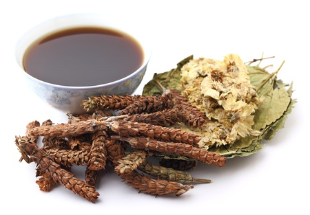 Chinese herbal medicine with drink photo