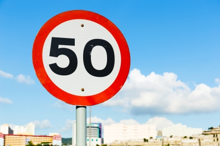 Road sign 50 blue sky background Stock Photo