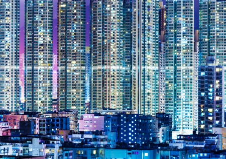 overpopulated: Overpopulated modern building in Hong Kong at night Editorial