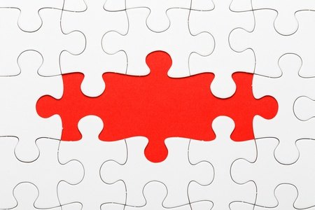 incomplete: Incomplete puzzle in red color Stock Photo