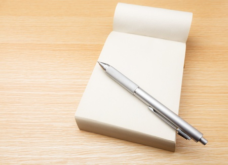memo pad: Memo pad and pen on the table Stock Photo