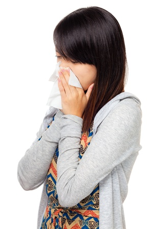 Sneezing asian woman photo