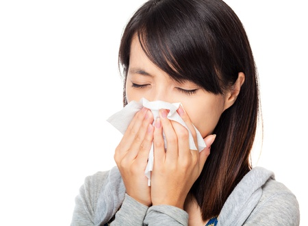 flu: Sneezing asian woman