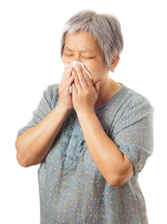 Sneezing asian elderly woman photo