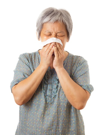 Sneezing asian elderly woman Stock Photo - 21884924