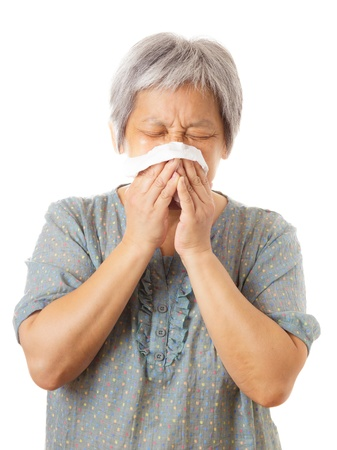 Sneezing asian elderly woman Stock Photo - 21884925