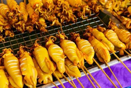Thai style roasted stick on street photo