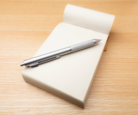 jot: Memo pad and pen on the table Stock Photo