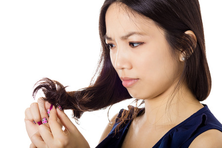 Asian woman with hair problem Imagens