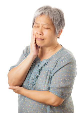 Asian old woman with toothache photo