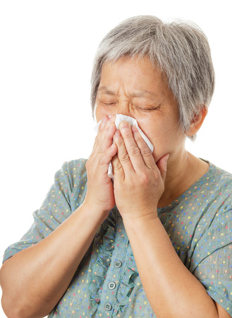 Sneezing of asian old woman photo