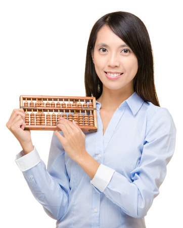 Asian woman holding abacus photo