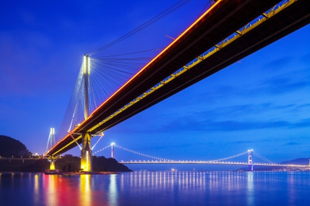 Suspension bridge in Hong Kong at night photo