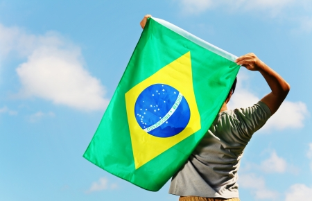 Brazil supporter holding a flag Stock Photo