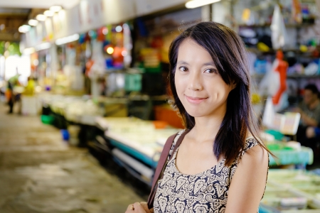 Asian housewife in the wet market photo