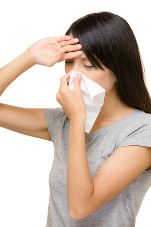 Sneezing asian woman photo